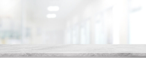 Empty white marble stone table top and blur glass window interior lobby and hall way banner mock up abstract background - can used for display or montage your products.