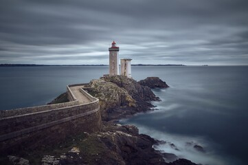 Petit Minou Lighthouse in France with a beautiful view of an ocean under a cloudy gray sky