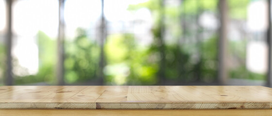Empty wooden counter bar, wooden table with blurred backyard background