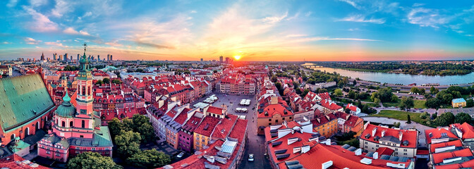 Beautiful panoramic aerial drone view on Warsaw Old town (POL: Stare Miasto) with modern skyscrapers on the horizon, Royal Castle, square and the Column of Sigismund III Vasa at sunset, Poland