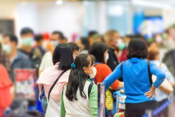 Crowd of people waiting in airport during coronavirus quarantine