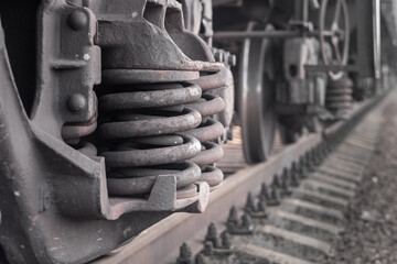 Closeup of wheelset springs at the railway multiple unit.