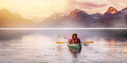 An adventurous couple in kayak paddle on a lake with rocky mountain background, Inspirational travel and leisure recreational, peaceful serene isolation