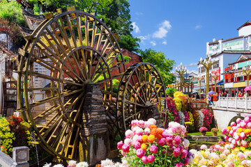Ornamental water mills and flowers, the Old Town of Lijiang
