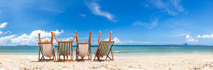 Cheerful friends in beach chair