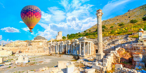 Hot air balloon flying over Antoninus Fountain of Sagalassos in Burdur, Turkey