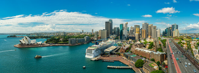 Panorama view of Sydney harbor bay and Sydney downtown skyline with opera house in a beautiful afternoon, Sydney, Australia.