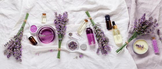 Lavender oils serum lavender flowers on white. Skincare cosmetics products. Set natural spa beauty products. Lavender essential oil, serum, body butter, massage oil, liquid. Flat lay long web banner