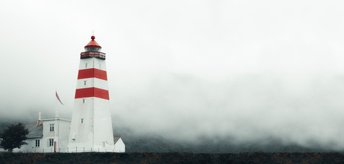 Beautiful Old lighthouse In Misty Day, located on Skrova Island, Lofoten Islands, Norway, Panoramic View