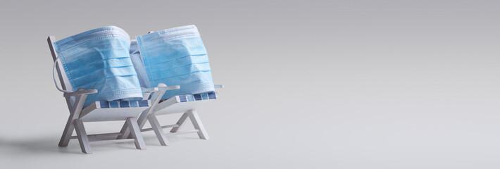 Pair of beach chairs with Coronavirus on vacation