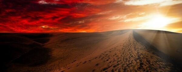 Night in the desert sand dunes. Desert against a dramatic red sky
