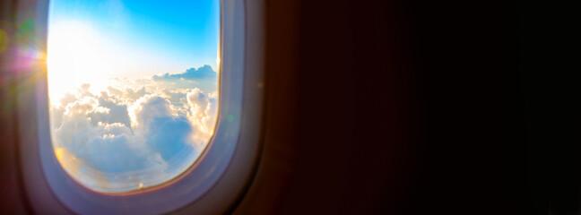 Sunrise through airplane window with copyspace banner