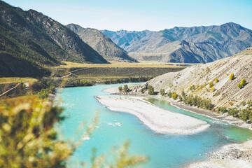 View of the turquoise river Katun and the Altai mountains, the autumn season