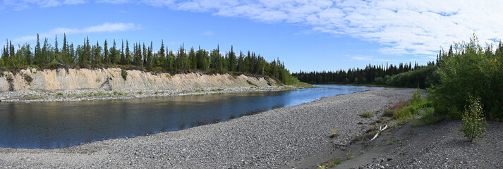 Summer panorama of the Northern taiga river.