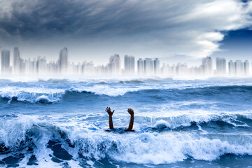 global warming and extreme weather concept. man drowning in the