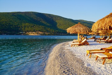 Bodrum, Russia - August, 2020: Beautiful tropical beach banner. White sand and coco palms travel tourism wide panorama background concept. Boost up color process. Luxury island resort vacation or