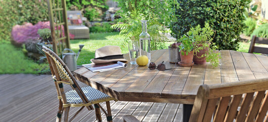table with drink and apple in a wooden terrace in countryside house for relaxation