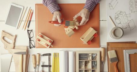 Creative craftsman and designer working at desk