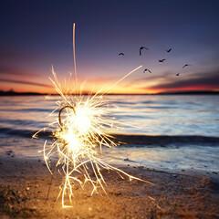 brennende Wunderkerze am Strand