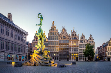 Brabo fountain on the 'Grote Markt' Square of Antwerp after sunset.