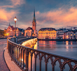 Сharm of the ancient cities of Europe. Adorable evening view of Fraumunster Church. Perfect autumn cityscape of Zurich, Switzerland, Europe. Sunset on Limmat River.