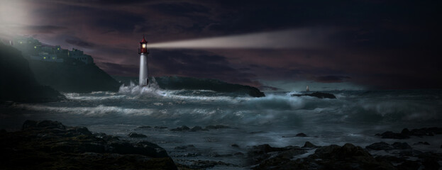 Lighthouse with beacon on coast in stormy sea with sailboat on horizon
