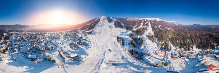 Panorama Sheregesh ski resort in winter, landscape on mountain and hotels, aerial top view Kemerovo region Russia