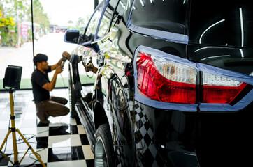 Man hand holding a car polish machine