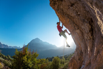 climber overcomes a difficult route