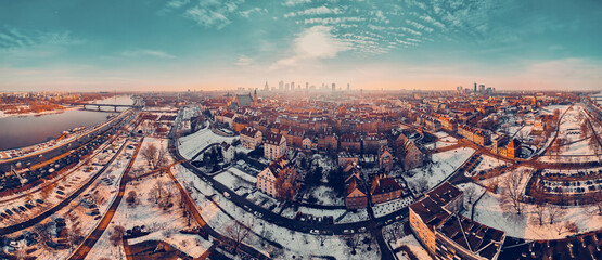 Beautiful panoramic aerial drone skyline sunset view of the Warsaw City Centre with skyscrapers of the Warsaw City and Warsaw's old town with a market square and a mermaid statue, Poland, EU