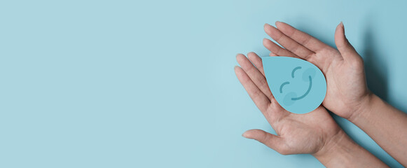 Woman hand holding smile water drop paper cut, world water day, clean water and sanitation, hand sanitizer and hygiene, washing hands, CSR, save water, clean renewable energy concept