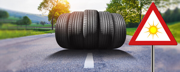 """summer car tires on the street outside with traffic sign """"summer"""""""