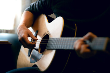 Young man playing acoustic guitar