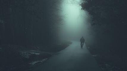 Postać rowerzysty we mgle