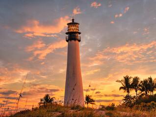 sunset beautiful sky lighthouse light sky orange clouds horizon palms