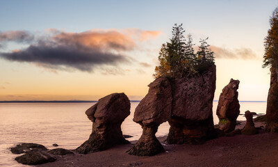 Panoramic view of Cape Rocks during a vibrant sunrise. Colorful Sky Art Render. Taken in Hopewell Rocks Park, New Brunswick, Canada.