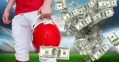 Composition of american dollar bills over midsection of american football player in sports stadium