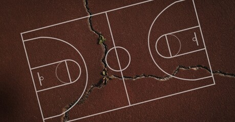 Composition of basketball court over brown cracked distressed surface