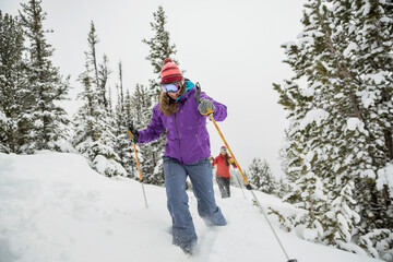 Women backcountry skiing in mountains