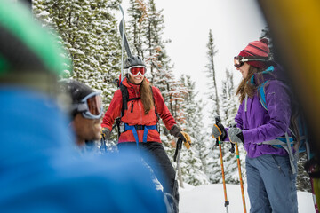 Group of backcountry skiers hiking in mountains