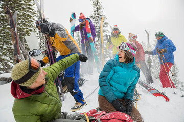 Group of backcountry skiers throwing snow