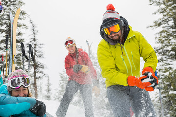 Group of backcountry skiers having a snowball fight