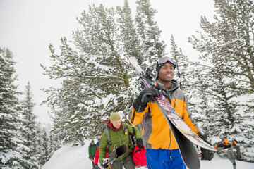 Group of male backcountry skiers hiking in the mountains