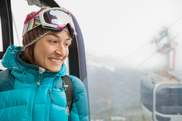 Smiling woman looking out gondola window