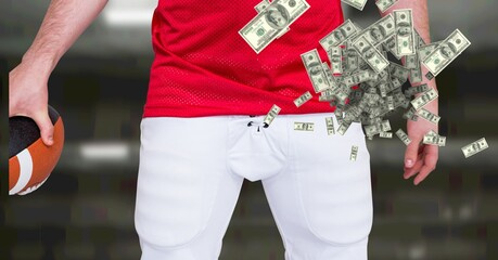 Composition of american dollar banknotes over midsection of american football player
