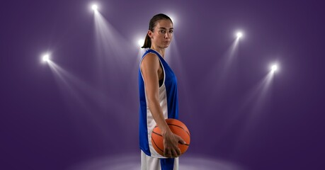 Composition of caucasian male basketball player holding ball with spot lights and copy space