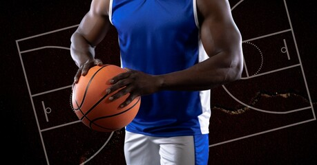 Composition of african american male basketball player holding ball over basketball court