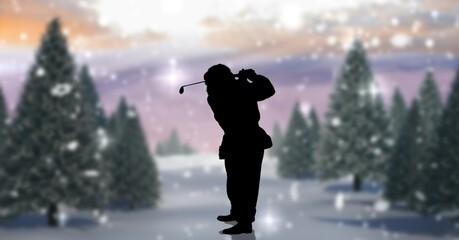 Composition of silhouette of santa claus playing golf over winter landscape