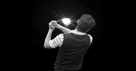 Composition of male golf player with golf club and copy space in black and white