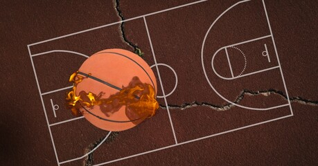 Composition of basketball on fire over cracked basketball court